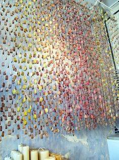 Art installation of tea bags covered in paint. Via abby jean.