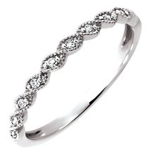 This elegant 1/20 carat total weight diamond twist ring looks great worn alone or stacked to create a bigger look.