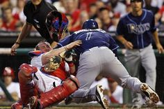 Sean Rodriguez knocks over Phillies catcher Brian Schneider at the plate during Sunday night (6-24-12) Rays 7-3 win.