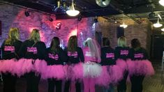 Laura's bachelorette party made their own tutus by taking 1/4 inch wide tulle and tying a knot around a piece of ribbon.  50 pieces later and voila--they looked so much cooler than the ones at the party store.