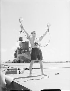 The batsman on board HMS ILLUSTRIOUS in the Indian Ocean. This signal indicates - Go higher for your approach.