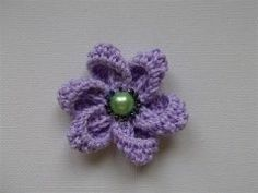 step by step pictures to show how to crochet this flower.