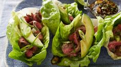 For a lighter spin on tacos, this version for Light Tacos uses crisp green lettuce in place of the usual shells. Grilled flank steak, a chile salsa and sliced avocado make up the tasty filling.