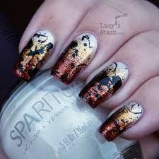 gradient splatter nails bronze, gold, black.