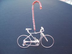 http://www.freedomwireart.com/collections/handmade-christmas-ornaments/products/unique-bicycle-christmas-tree-ornaments-decorations-gifts-handmade-candy-cane-freedom-mountain-bike