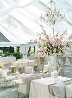 Love the furniture, chandelier and soft tent.