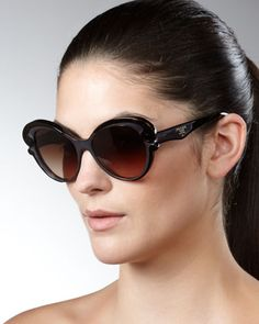 Cat-Eye Sunglasses, Brown by Prada at Neiman Marcus.