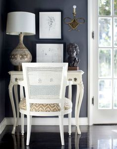 white french desk + cane chair with geometric fabric. love the styling too.