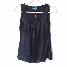 Black Silk Tank Gorgeous silk tank with gathered/pleated front. Has side zipper. Black in color. 100% silk. Raw edge around collar. White + Warren Tops Tank Tops