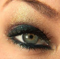 Dark green and gold eye shadow
