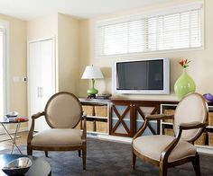 Position diffused, low-watt lighting, such as sconces with frosted glass shades or table lamps on dimmers, behind and slightly to the side of your TV: http://www.bhg.com/rooms/living-room/family/living-room-decorating-ideas/?socsrc=bhgpin040514addlowlighting&page=6