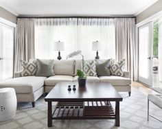 grey rug and sage walls with a lighter couch