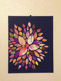DIY flower art using kids paintings... Just painted the canvas, cut child's paintings into leaf shapes and glued onto canvas with mod podge or fabric glue