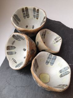 Emily Parr Budge over  group of pinch pots  #pottery #clay #incise