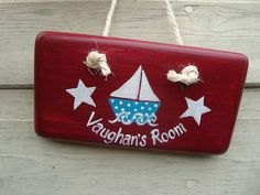 sailboat sign_country red with peacock blue boat