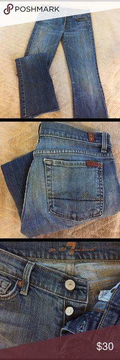 """7 For All Mankind Boycut flare jean Pre-loved """"boycut"""" slightly flared jeans with button fly. These are great quality denim with a little stretch and are so comfy. Some fraying/tearing on bottom back cuffs, otherwise great condition. 7 For All Mankind Jeans Flare & Wide Leg"""