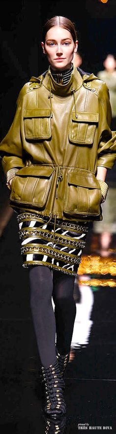 There's something very pleasing and disturbing about this peace. I love the color combo of eggplant and this ochre gold. But the jacket looks like pleather - ugh. I do love the skirt and the tights together. nice. Balmain F/W 2014 - Paris Fashion Week | The House of Beccaria~