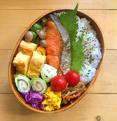 Bento box featuring grilled salted salmon, tamagoyaki, lettuce & chikuwa roll-ups, mashed kabocha salad, pickled purple cabbage, sauteed mushrooms & green peppers, and rice topped with furikake.