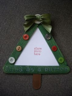 Paint 3 craft sticks green. Adhere sticks to form tree and add a star or button & bow to top of tree. You could also punch out a star from cardstock to top the tree. The tree trunk is a craft stick painted brown. Add photo, buttons and magnet to back of tree and you're done!