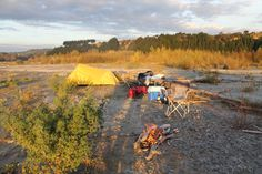 Simple riverside campsite on a solo River Valley Lodge to Sea catarafting trip on the Rangitikei River, New Zealand.