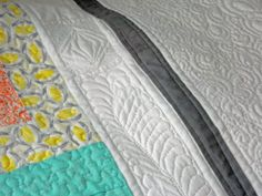 04/13/14- http://www.tidelinequilts.com/Blog.html?entry=spring-mix-quilt-in-the Free Motion paisleys in the outer border.  Free Motion stippling in all the blocks. Then, I drew out a design which includes dot-to-dot quilting and Free Motion feathers for the inner border.  Here's how it looks on the actual quilt...