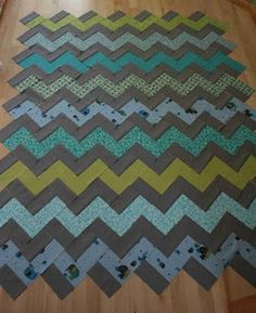 "OOOOHHHH!  LIke this...better than all those triangle!  LOL  Do you like the patern? (still deciding on ""background"" fabric color). ANd MIGHT even mix n match the ""accent color"" blocks so that it is not a row of the same exact fabric in each zig zag. you know what I mean?"