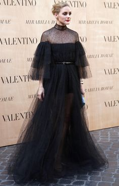Olivia Palermo proves that a belt is elegant enough for evening wear when styled correctly.