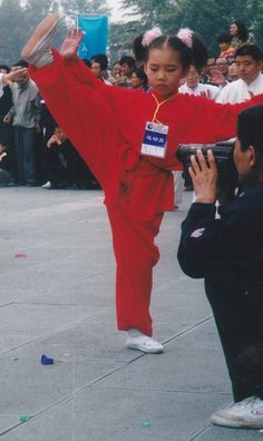This little lass at the tender age of 6 years old played beautiful wushu Pic form the opening 1999 in Yong Nian international Tai Chi Festival China
