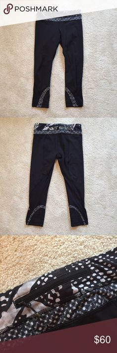 Black Lululemon Running Leggings with Pattern Black running leggings by Lululemon. Cropped style with black and white patterned detail at waistband and ankles. Features adjustable waistband and convenient back zipper pocket. lululemon athletica Pants Leggings