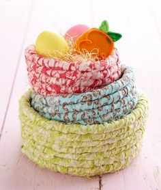 Cover cord with fabric strips and start coiling. You'll wind up with a trio of baskets that are perfect for gifts or cute storage!