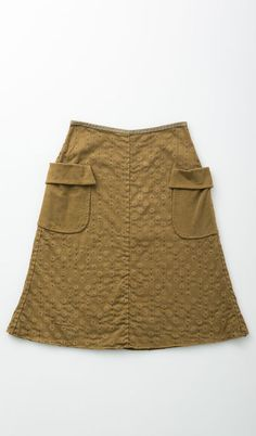 Tecture + Embroidery + Pockets Double layer of lightweight cotton. Looks like the dot pattern is stenciled on??