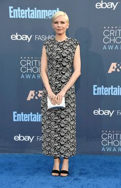 Michelle Williams wearing a Louis Vuitton Spring 2017 floral lace dress with a high slit to the Critics Choice Awards 2016