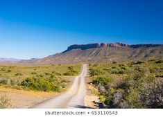 Gravel road crossing the majestic landscape at Karoo National Park, travel destination in South Africa. Royalty Free Images, Royalty Free Stock Photos, South Africa, Travel Destinations, National Parks, Landscapes, Country Roads, Illustration, Pictures
