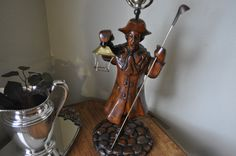 Please feel free to check www.Likethatbea.com for more interesting items.  Unique, 1800s style, lantern worker table lamp. This is a wooden sculpture incorporated into a table lamp. this man is holding a long snuffer to put the lights down and small lantern, in the other hand, to guide his way. It is working table lamp with a top switch for the large light and the base switch for the small lantern. He is standing on wood carved brick surface. Great lamp for old style homes, cottages…