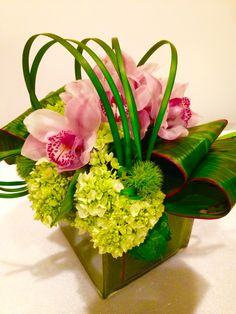 Hydrangeas, orchids and leaves.