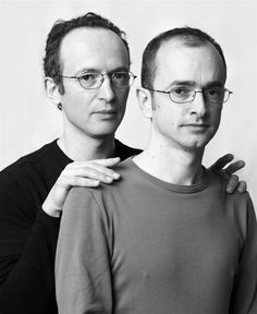 """I'm Not a Look-Alike! - The pairs in these images are not twins - or even related. Instead, they're strangers that Canadian photographer Francois Brunelle photographed together: a project called """"I'm Not a Look-Alike!"""" He spent 12 years tracking down people with eerily similar features. Pictured here: Marcel Stepanoff, Ludovic Maillard"""