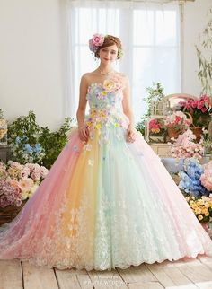 How pretty is this pastel rainbow gown from Nicole Collection featuring 3D floral accents and dreamy lace details?