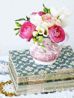 Cottage flowers in red transferware on stack of old books  hearthandmadeuk: