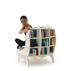 The Shelf Chair is both a comfortable seat and a bookshelf unit. A great space saver, Shelf Armchair is ideal for modern apartments or small rooms where separate bookcases and shelving isn't feasible alongside seating.