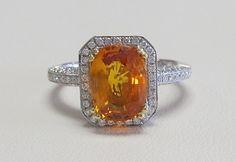 2.50 carat orange sapphire set in a 14k white & yellow gold .63 carat total weight diamond setting!