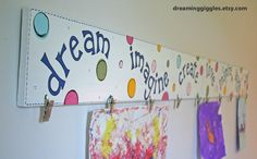 children's artwork hanger - All it took was 1 time hanging Alana's art work on the fridge and she always wants to showcase it & there is just not enough room. I am definitely going to make one of these!