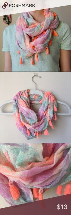 Neon Feather Circle Scarf American EagleOutfitters Item: Neon Tassel Feather Circle Scarf  Size: One Size Brand: American Eagle Outfitters Color: Bright orange, teal, and purple feather print Style: Circle scarf with tassel details Condition: Worn a couple times Weight of item: 2.40 oz American Eagle Outfitters Accessories Scarves & Wraps