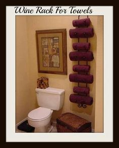Wine rack for towels..love this idea