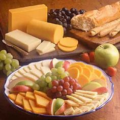 Fruit is a great complement to the varieties of cheese on this platter.