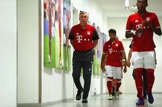 Carlo Ancelotti head coach of Muenchen walks at the players tunnel with his players Juan Bernat and David Alaba prior the pre season friendly match...