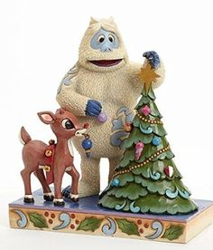 Disney Traditions Jim Shore Rudolph the Red-Nosed Reindeer and the Bumble Figurine depicts a scene from this holiday classic television program in which the Bumble and Rudolph decorate the Christmas tree.  Beautifully handcrafted with the color and folk art style of artisan Jim Shore. #rtrnr