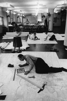 Census Bureau geographers check the accuracy of census maps using aerial photos & magnifying glasses in the 1960s.Learn more: http://www.census.gov/history/www/programs/geography/