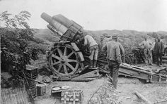 German 21cm Mörser M1910 in position on the Western Front.  The gun is easily recognizable from the later 1916 model because of the lack of the fragmentation shield.  Note the ammunition baskets to the left of the gun.