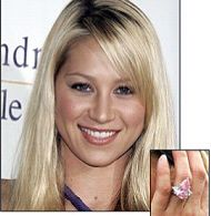 Enrique Iglesias proposed to Anna Kornikova with a stunning 11-carat natural pink pear shape diamond in a simple semi-mount with diamond accents. The ring comes from the worlds biggest mine in Argyle in western Australia, where diamonds have a unique champagne and cognac color. The estimated value of this gorgeous ring is approximately $6 million dollars.