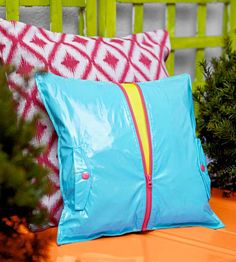 Rain or Shine Outfit an outdoor pillow with a waterproof cover made from an old rain jacket to create an object that?s both sturdy and stylish. Trim the rain jacket down to your desired pillow size and sew the front and back pieces together. Leave the zipper and pockets intact to hint at the cover?s previous life